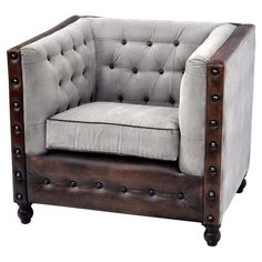 Draper Arm Chair - Wrapped in canvas and showcasing distinctive nailhead-trimmed leather accents, this striking arm chair brings handsome style to your office or library. Joss & Main