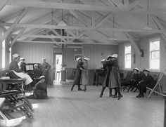 Women of the Women's Royal Naval Service (WRNS) enjoy a dance in their recreation room on Osea Island in Essex during the summer of 1918., L...