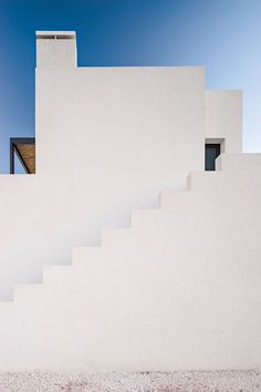 Located in the settlement of Kampos, this house composed of stark white volumes is enhanced by the sublime surrounding rural landscape #total #white