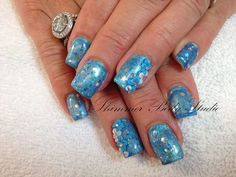 Gel nails, blue nails, glitter nails, 3d sculpted nail art by Shimmer Body Studio.