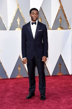 Presenter Chadwick Boseman wore a Giorgio Armani midnight blue two-button notch lapel chevron pattern dinner jacket trimmed in grosgrain with classic evening trousers, a classic white evening shirt and a bow tie.