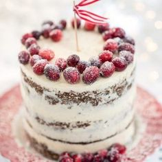 This Festive cranberry orange and walnut cake with mascarpone frosting is topped with a beautiful frosted cranberry crown.