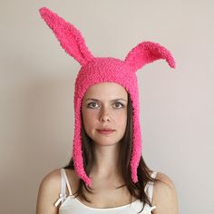 Pink Bunny Ears Hat  This warm hat is hand-knitted with soft acrylic yarn. The ears are framed with wire that allows to stand up. Other colors are