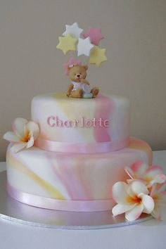 This is another adaptation of the marbled christening cakes I have done. It was a pink, yellow and white, frangipani themed christening, so this is what I came up with. The flowers are artificial and the bear is ceramic.