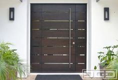 Modern Entry Door Systems in Orange County, CA | Custom crafted in mahogany with a contemporary stainless steel tubular pull handles! by DynamicGarageDoors
