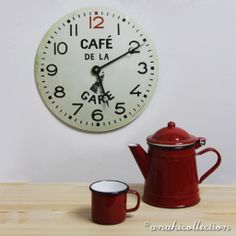 CAFÈ DE LA GARE CLOCK Based on the original Cafè de la Gare clocks, this authentic looking tin bistro clock which you might have seen near a French railway station years ago. The porter with his luggage adds that extra charm to the convex metal dial. Great for adding a bit of je ne sais quoi to your kitchen. #ANAHICollection #living #interiordesign #interiors #clocks