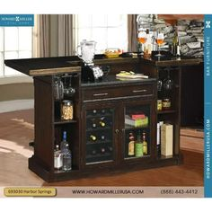 693030 Rustic Hardwood Wine and Bar Console Furnishings Howard Miller This handsome bar features a rustic antique metal bar top with decorative nailhead trim, two inset panels with a random parquet veneer design and an antique brass-tone foot rail.