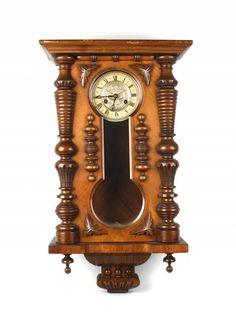 A walnut cased Vienna wall clock