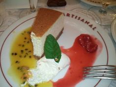 #Cheesecake with passionfruit sauce on left and berry sauce on right from Artisanal