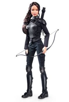 """The Hunger Games: Mockingjay Part 2 Katniss Doll The Barbie Collection Katniss is outfitted in a detailed costume inspired by the film. Her futuristic all-black outfit features molded shoulder and chest armor with wings on the back, knee guards, and combat boots with shin guards.She's armed with a bow and quiver of arrows, and wears the iconic Mockingjay """"pin."""""""