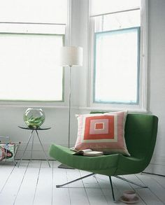 Green chair / via homebug I don't like fussy pillows that are just for decoration, but sometimes, throwing a cushion in just the right spot gives your lived-in look a sweet finish that makes it all good.