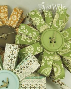 Scrapbook paper (or maybe recycled book pages with watercolor?) + buttons + burlap = parts for wreath?