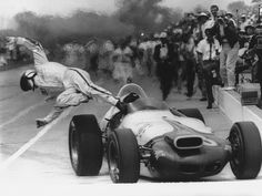Defending champion Parnelli Jones dives sideways out of his flaming car when it caught fire in the pits, eliminating him from the 1964 race. Jones, who won in 1963, was hospitalized with burns but was not seriously hurt.