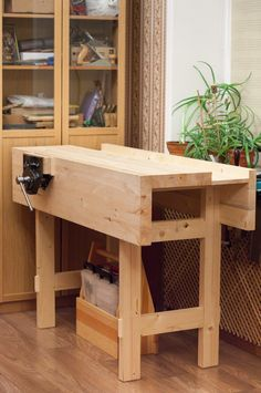 Workbench, very sturdy top, like torsion box; cannot clamp from side; tool tray on top