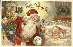 Santa looking over a sleeping child