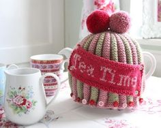 Lovely knitted tea cosy. Fab colours