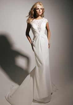 Gown features beading and lace.