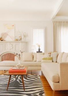 zebra rug and neutral sectional sofa