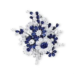 DIAMOND FLORAL CLIP BROOCH, BY BULGARI   Designed as a floral spray, the sapphire and diamond flower heads set en tremblant, to the baguette-cut diamond branches enhanced by vari-cut diamond and sapphire accents, mounted in platinum, late 1950s