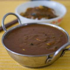 South Indian style Tamilnadu Spicy Chettinad Poondu Kuzhambu recipe with step by step pictures.