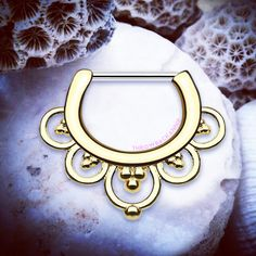 ✨www.throwbackannie.com✨ Add a touch of gold to your wardrobe with our pretty petal septum clicker! Floral septum jewellery that looks ultra perf in your septum piercing!
