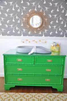 Refinished Kelly Green Vintage Dresser in a modern safari nursery  - LOVE!