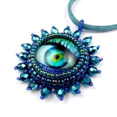 Blue Eye Pendant, Purple Beaded Eyebal, Alien Jewellery: The Seer. £20.00, via Etsy.