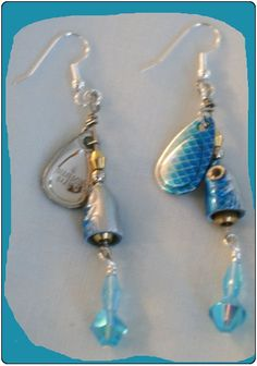 http://diginanchors.com/EarringsAlure_DropBlueMako - Dangling earrings made with beautifully purple finished, high quality lures.  Added to each fishing lure is sparkling purple beads and crystals matching the color of the lure.The unique earring are 3 and 1/4 inches long.The earrings are hung on silver plated earwires made with surgical stainless steel.