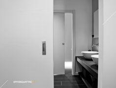Atrium di Parma Ghost + scorrevole interno muro frassino bianco