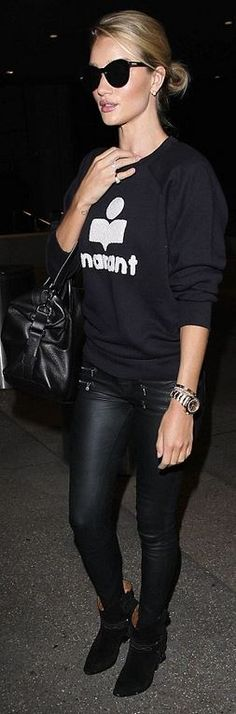 Who made  Rosie Huntington-Whiteley's gold watch, suede ankle boots, print sweater, skinny zipper jeans, and jewelry?