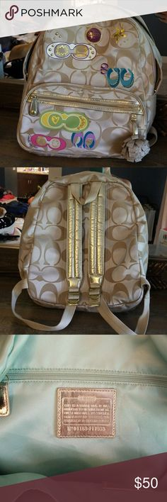 Coach backpack My favorite backpack, ever ! Gold ans tan with colorful coach accents. Coach Bags Backpacks