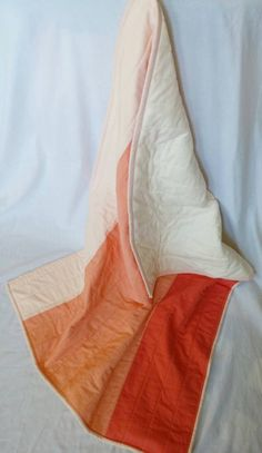 Modern Peach ombre baby quilt with ivory minky backing.