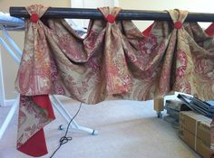 Victory Valance custom made for your windows in your choice of fabrics and lining and trim. $225.00, via Etsy.