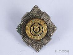 Vintage white metal collar badge for the Royal Scots Regiment