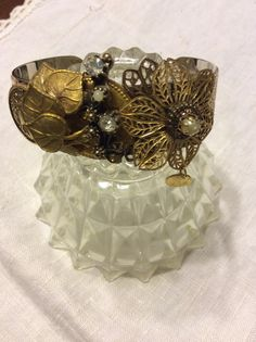Assemblage flower and leaf motif cuff with by FINDINGMYTRIBE, $38.00