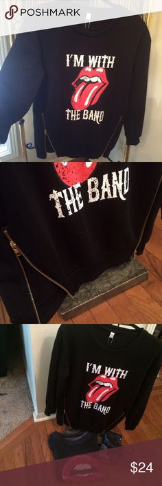 """NWT I'm with the Band"""" Sweatshirt w/zipper accents This is so cool! The graphics are so awesomely textured and distressed, perfectly! No fabric content stated but seems like typical soft sweatshirt material with a fleece lining. Does say to dry clean only on tag, I don't know why tho? Anyway, to continue, accent yet functional zippers towards the bottom, in gold. Measures 18"""" across bust and is a nice 27"""" L. Slightly dropped shoulders, sleeve length 22"""". Ribbed crew neck, banded ribbed…"""