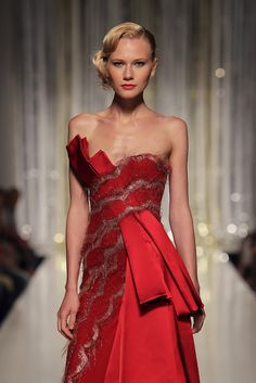 TONY WARD - Red asymmetric lace evening dress with cascades of Duchess satin pleats.