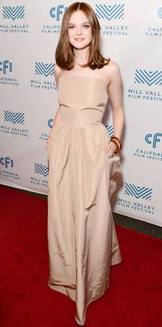 Elle Fanning graced the Low Down screening at the 2014 Mill Valley Film Festival in a neutral strapless Rochas gown that perfectly complemented her newly dyed brunette strands.