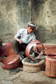 Kashgar, China Metal Worker  | In China? try www.importedFun.com for Award Winning Kid's Science |