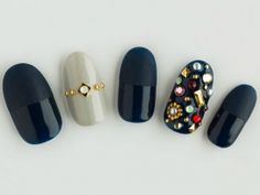 Black & bejeweled nail art