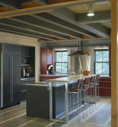 Modern architectural gray and maroon kitchen with raised eating bar behind the island. Modern Grey Kitchen, Red Kitchen, Kitchen Ideas, Exposed Ceilings, Exposed Beams, Black Ceiling, Ceiling Beams, Home Board, Basement Remodeling