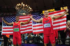 Ashton Eaton (L) of the United States and Trey Hardee (R) of the United States celebrate under the Olympic Cauldron after winning GOLD & Silver, respectively in the Men's Decathlon on Day 13 of the London 2012 Olympic Games at Olympic Stadium on August 9, 2012 in London, England.