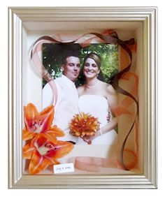 Cute wedding shadow box... I like how she only kept a couple flowers from the bouquet to keep it simple.. and the picture of them includes the bouquet
