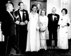 King Constantine and pregnant Queen Anne-Marie pose before an official dinner.