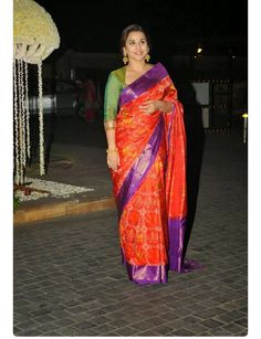 Vidya Balan in her signature style. Great colors! Nice to see a non matching blouse.