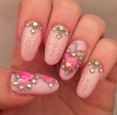Pink glitter oval gel nails with crystals, beads and liquid gem
