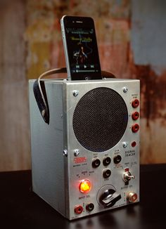 ipod iphone charging station with speakers from vintage radio test equipment. $225.00, via Etsy.