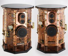 This pair of Empire Steam speakers was handmade by Airhammer Industries. Each octagonal cabinet is made from MDF with a copper veneer, copper edging, and brass and bronze details. They're extremely substantial, as is evidenced by the large 1.5″ thick granite top on each one, and an approximate weight of 125 pounds per speaker.