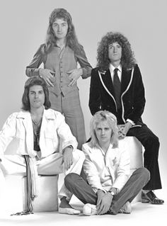 Queen looking particularly terrible, each sporting inspiringly bad hair
