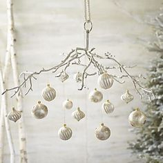 hanging aluminum branch in decor crate and barrel could make this out of natural branch painted silver hang snowflake ornaments and votive candles from aluminum crate barrel